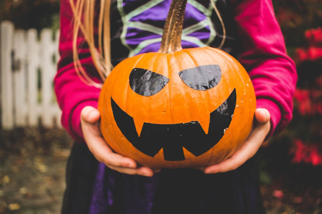 Pumpkins and halloween with adopted or foster child